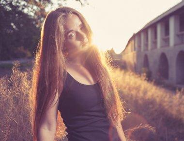 Blonde women at sunset backlit