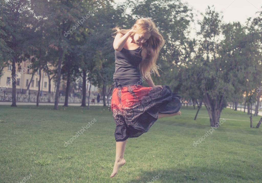 Girl jumping like flying bird