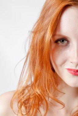 Half face portrait of a  woman.