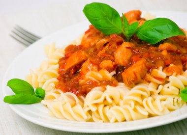 Fusilli pasta with chicken breast in tomato sauce
