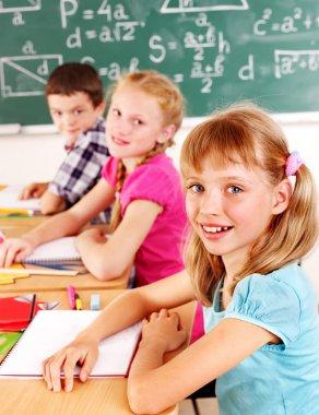 School child sitting in classroom.