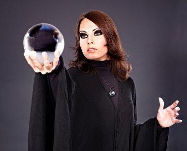 Woman with crystal ball.