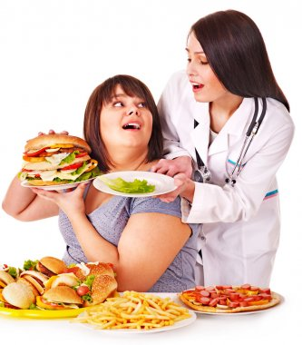 Woman with hamburger and doctor.
