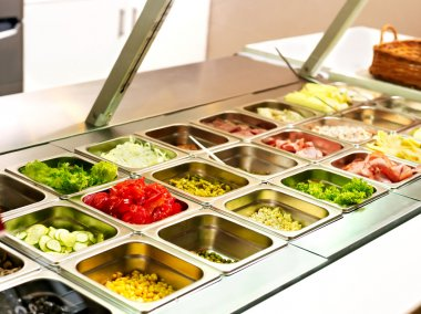 Tray with food on showcase at cafeteria