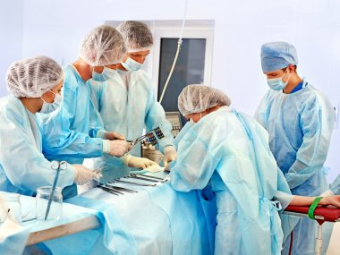 Surgeon at work in operating room.