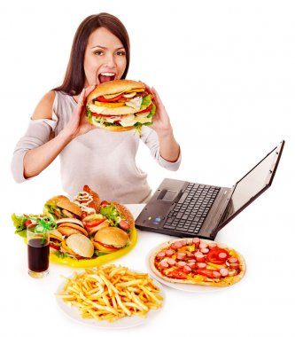 Woman eating fast food at work. Isolated. stock vector
