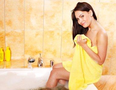 Woman undressing in bathroom