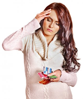 Woman with headache take pills and tablets.
