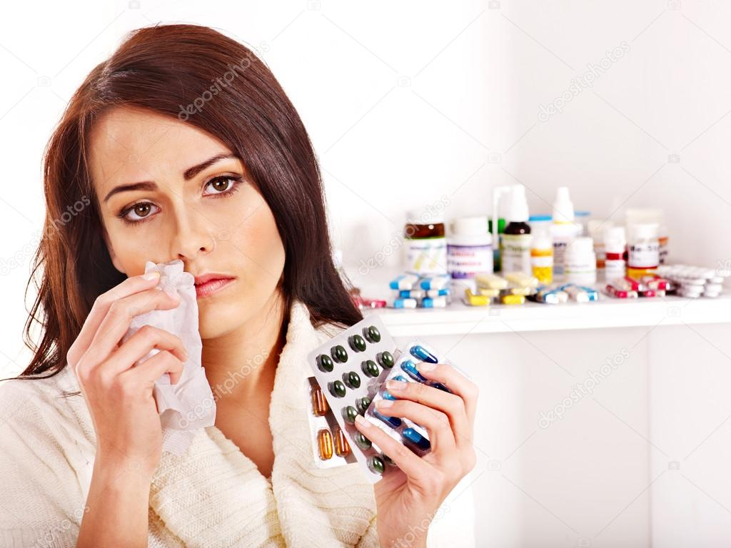 woman with handkerchief having tablets and pills stock photo