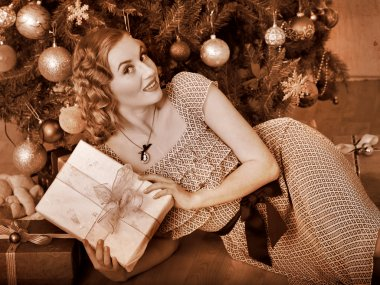 Woman receiving gifts. Black and white retro.