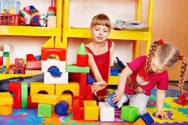 Little girls plaing block and construction set