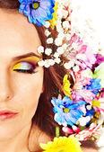 Fotografie tvář ženy s květinou