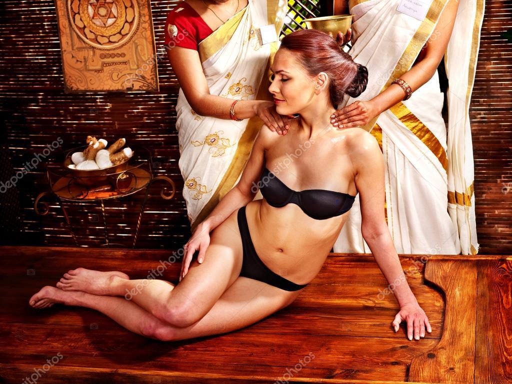 woman having ayurvedic body spa massage. — stock photo © poznyakov