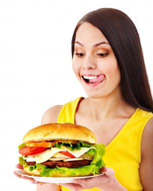 Woman holding hamburger. Isolated. stock vector