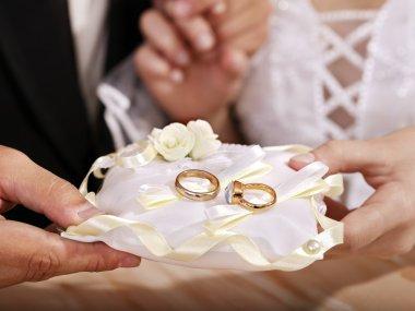 Wedding ring on pillow.