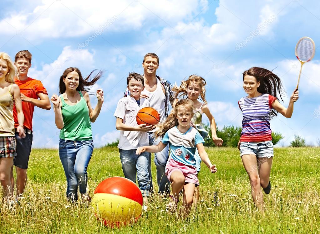 Group with children running.