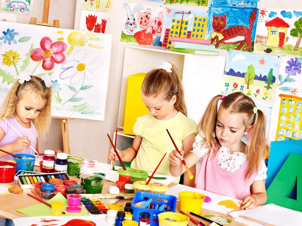 happy children painting at school photo by poznyakov - Children Painting Images