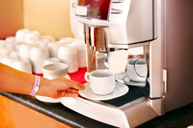 Hand with coffee machine.