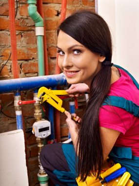 Woman builder with special tool.
