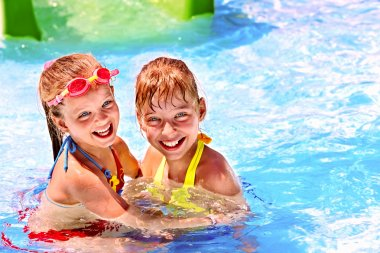 Children in water at aquapark.