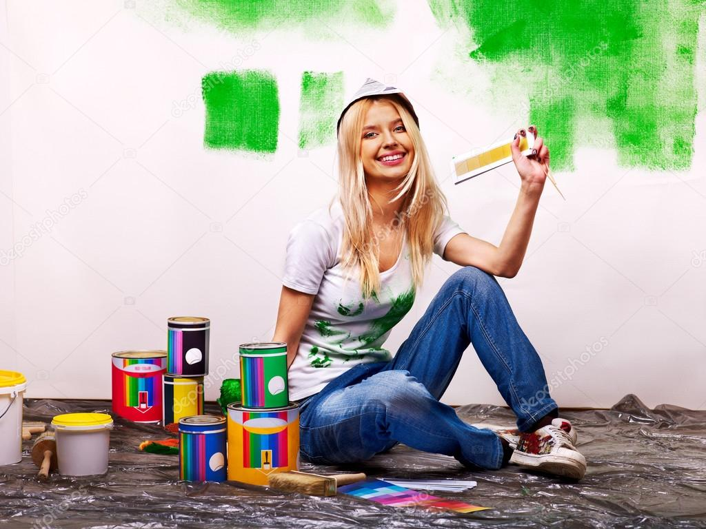 Woman Painting A Wall In House Stock Photo - Image of