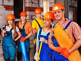 Photo Group people in builder uniform.