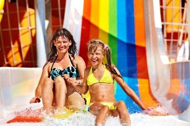Family  in bikini sliding water park.