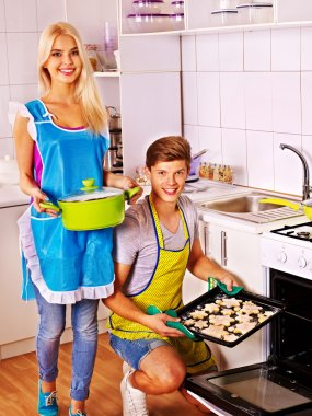 Couple baking cookies in the oven