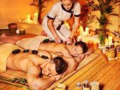 žena a muž se kamenné terapie masáž
