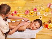 Fotografie žena stále kamenné terapie masáž