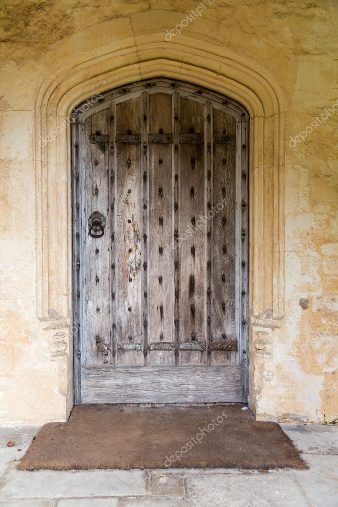 Old Oak Wood And Stud Door In Cotswold Stone Entrance Archway U2014 Photo By  Steveheap