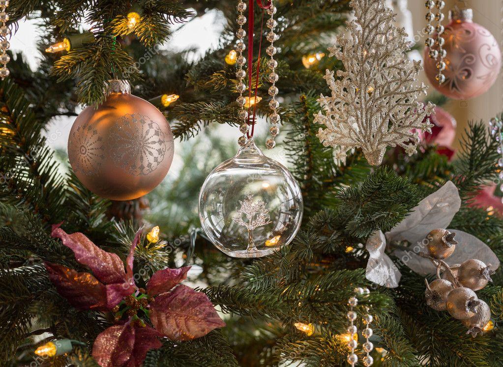 Glass globe on christmas tree detail