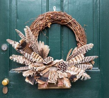 Traditional xmas wreath on front door