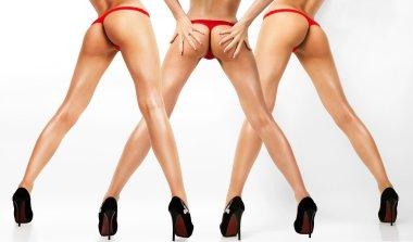 Three pairs of female legs.