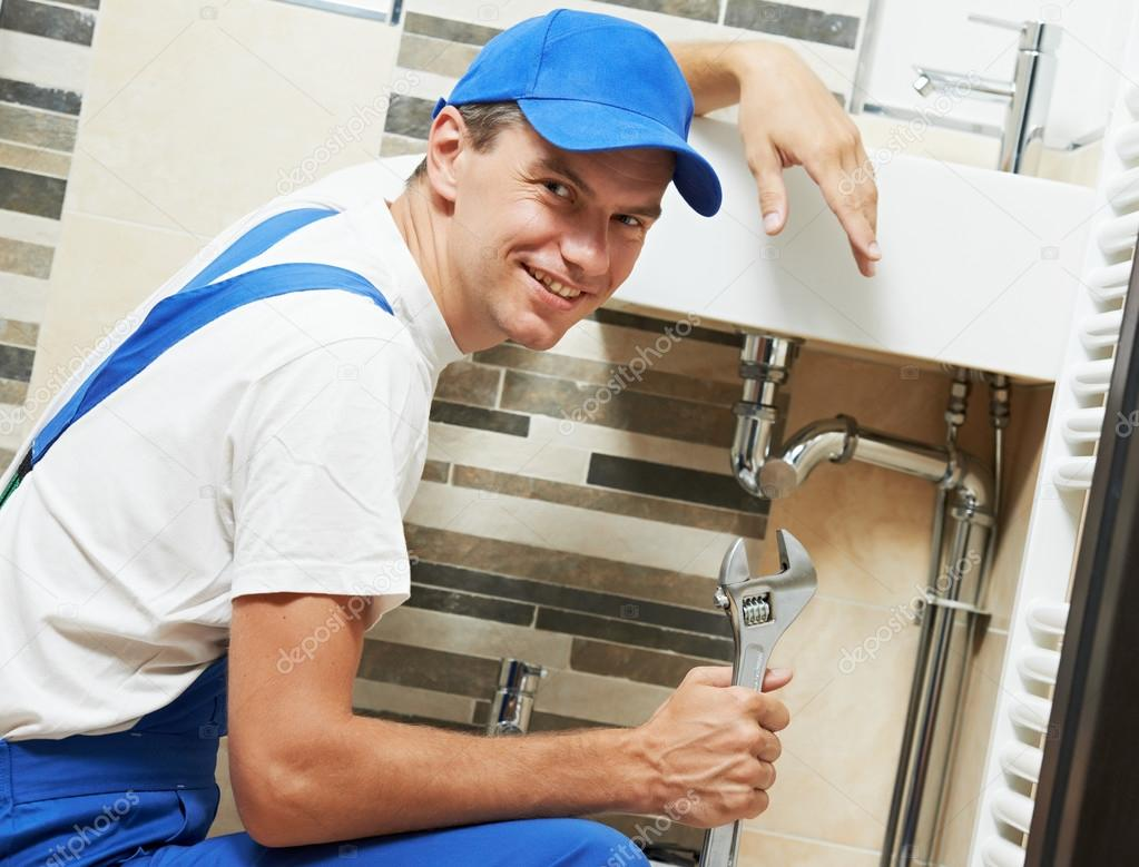 Young smiling plumber man worker — Stock Photo © kalinovsky #37553389
