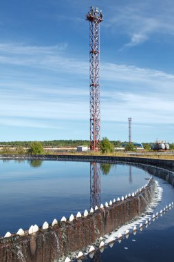 Blue sky reflection in sedimentation settler on treatment plant