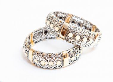 Two white gold braceletes on white background stock vector