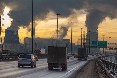 SAINT-PETERSBURG City ringway with cars and air pollution from heat electric generation plant in Saint-Petersburg