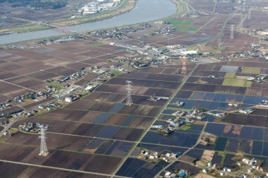 Japanese countryside with rice fields, power electric lines and small villages, Japan