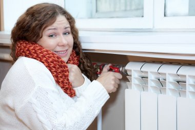 Woman feels cold when turning thermostat
