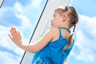 Girl behind plastic window