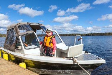 Child on motor boat