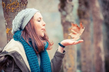 Beautiful Young Woman Outside with Falled Leaf