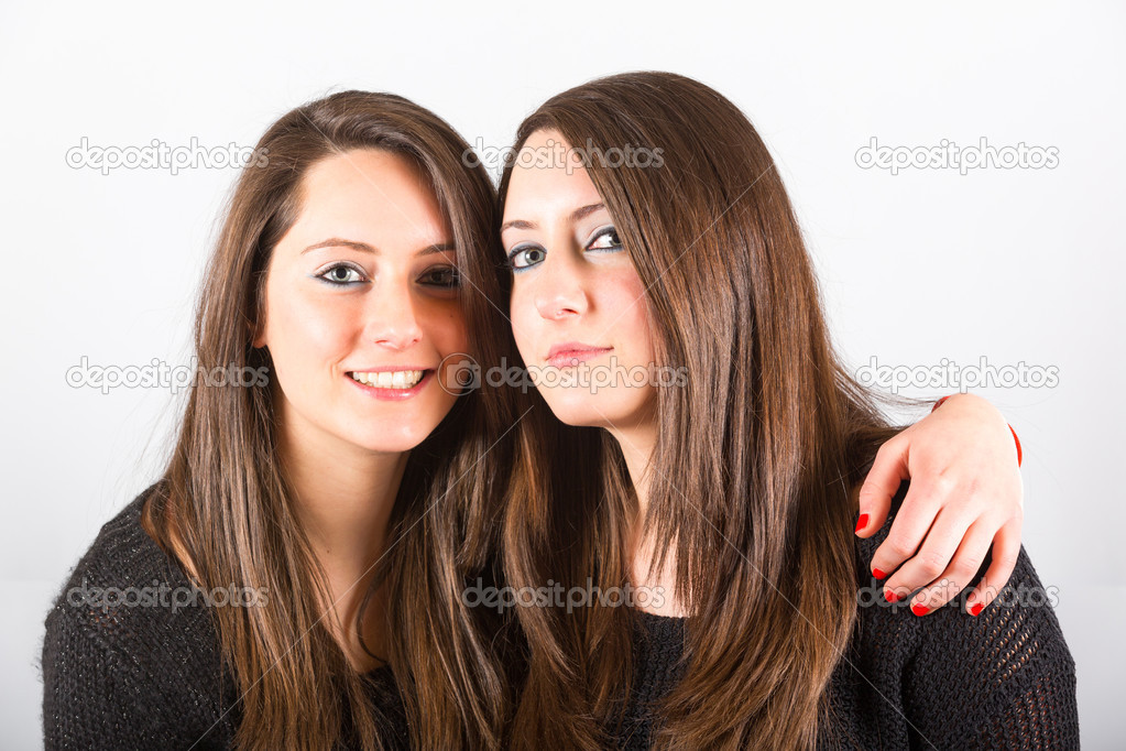 Two beautiful twin sisters embraced stock photo - Spa en dos hermanas ...