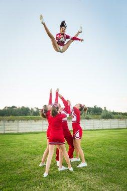 Group of Cheerleaders Performing Stunts