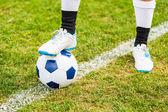 futball labda, és a játékos láb