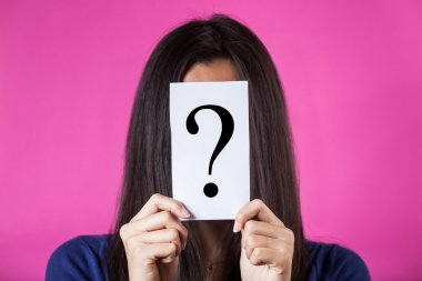Woman Hiding Face Behind a Question Mark
