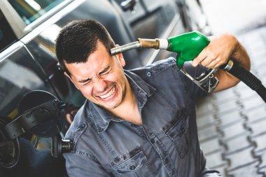 Desperate Man Using Fuel Pump as Gun