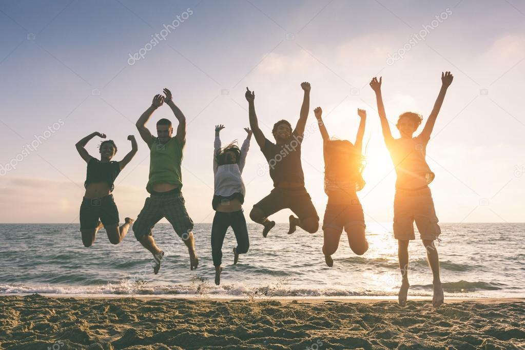 People Jumping at Beach