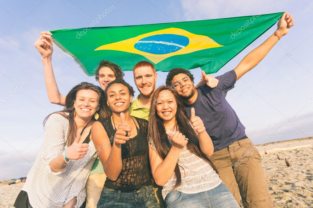 Friends with Brazilian Flag at Beach